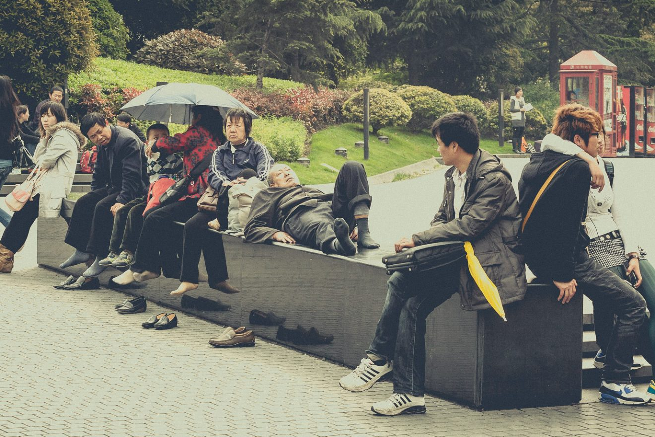 People sitting on monolith at People's Square, Shanghai