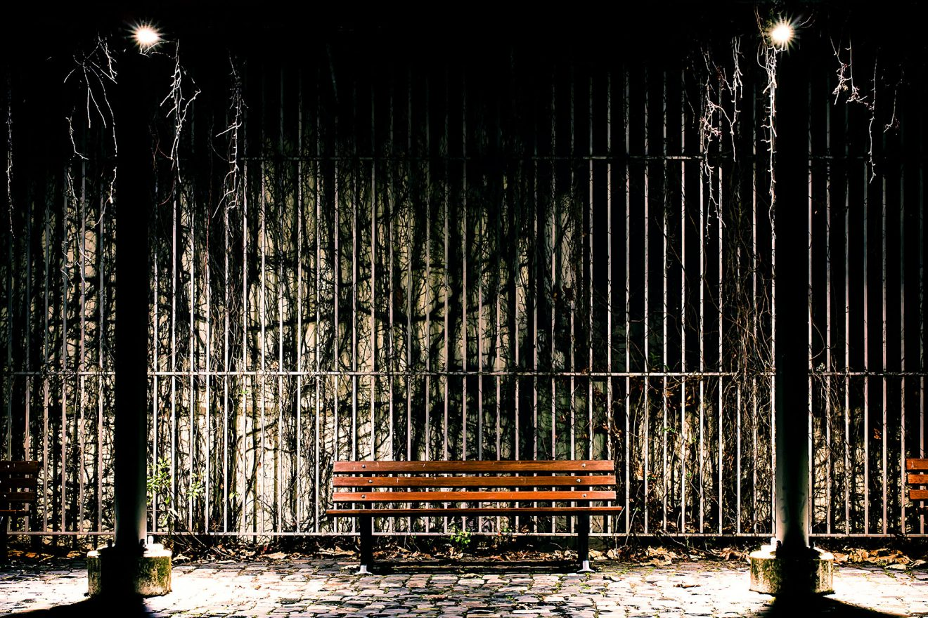 Bench in darkness and sinister light