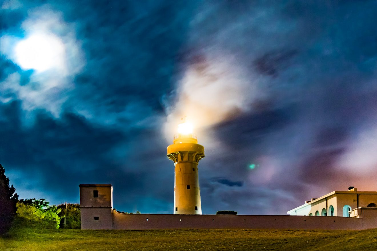 Cloudy sky and full moon over the lighthouse of Eluanbi, Taiwan