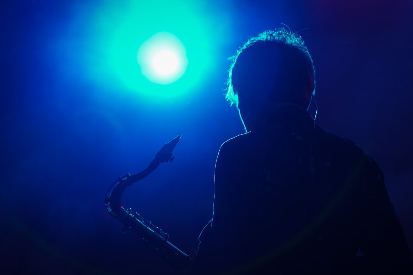 Saxophonist in blue light