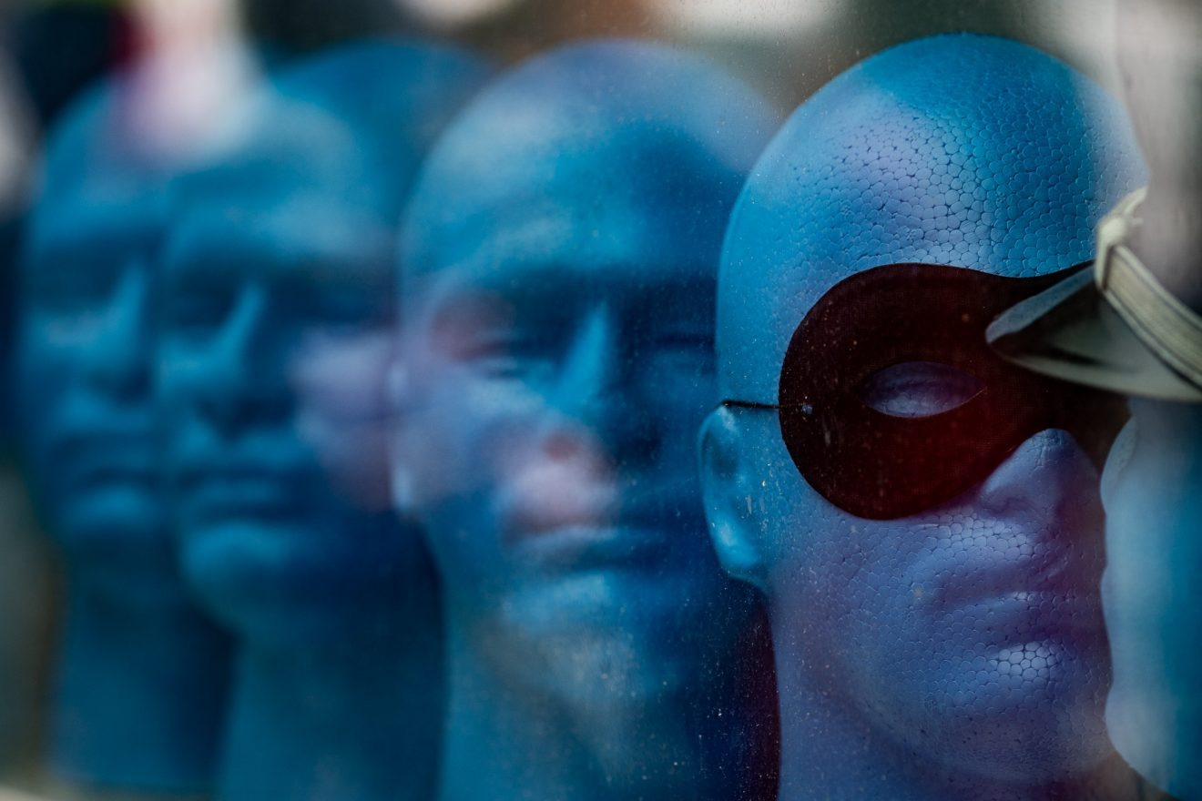 Blue male mannequin heads looking