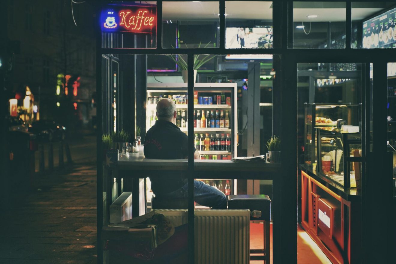 Man sitting in night cafe