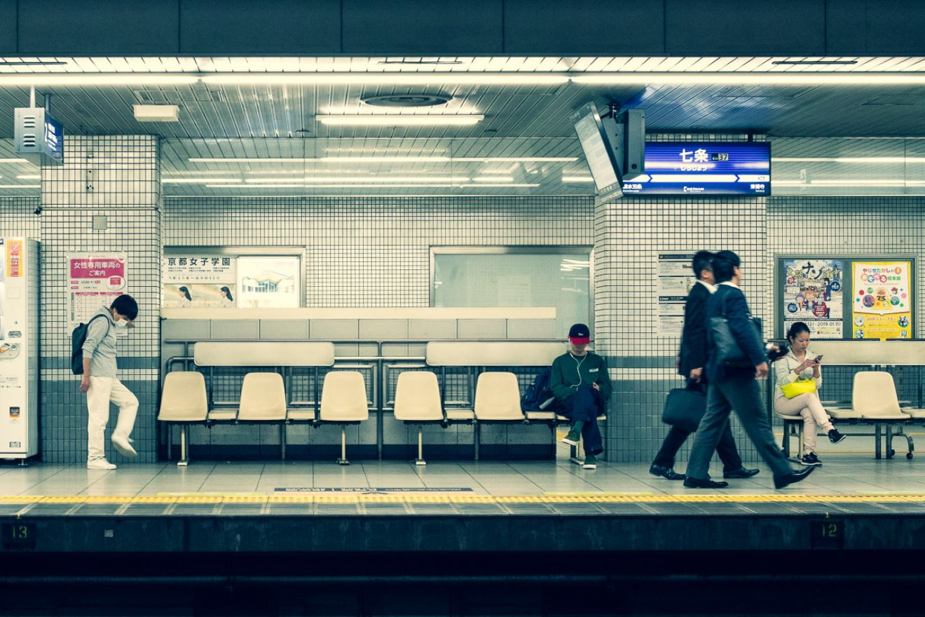 Metro station in Kyoto, people waiting