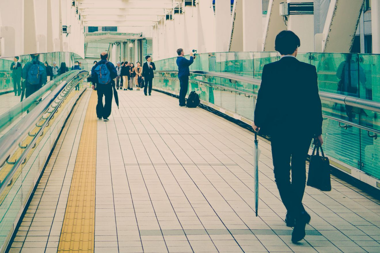 business men walking a passage