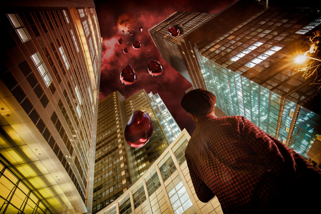 Figure in between skyscrapers, looking at sky, blood red giant raindrops